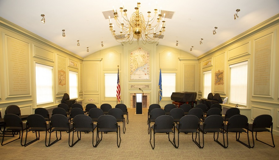 image of memorial room with two sections of chairs in rows separated by a center aisle